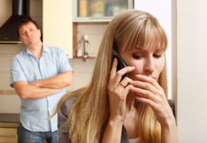 Couple in Conflict on Phone